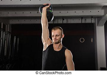 Man Doing Kettle Bell Exercise