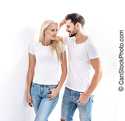 Portrait of a young, attractive couple wearing casual clothes