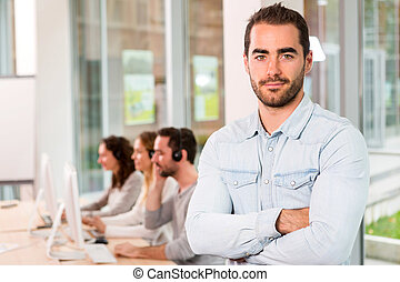 Portrait of a young attractive man at work