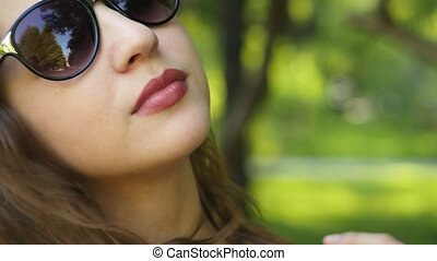 Portrait of a young attractive woman in sunglasses
