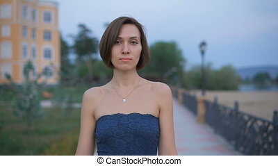 Portrait of a young, attractive woman in the street.