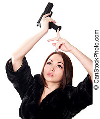 Portrait of a young attractive woman loading a gun