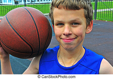 Portrait of a young basketball player with a ball