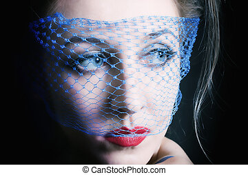young beautiful blue-eyed women in veils