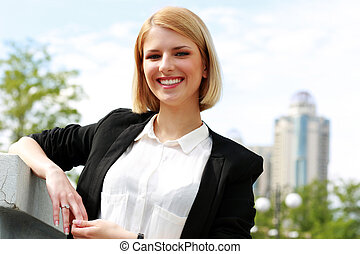 Portrait of a young beautiful cheerful woman