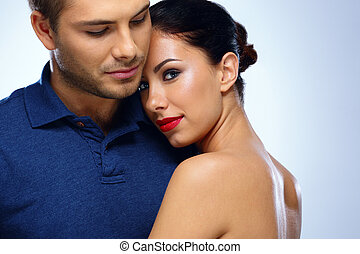 Portrait of a young beautiful couple hugging
