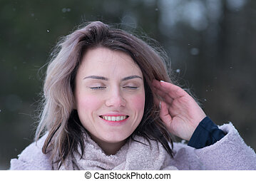 portrait of a young beautiful girl outdoors in winter