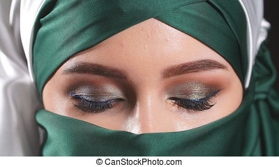 Portrait of a young beautiful muslim woman. - Portrait of a...