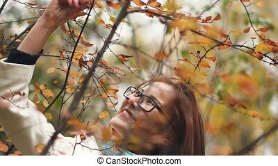 Portrait of a young beautiful woman in an autumn park