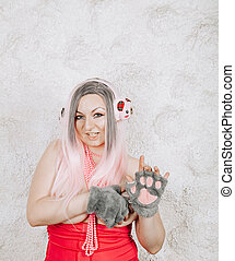 Portrait of a young beautiful woman in ear muffs on white background