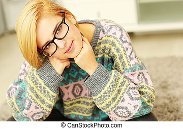 Portrait of a young beautiful woman in glasses looking at camera