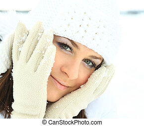 Portrait of a young beautiful woman  in winter outdoors