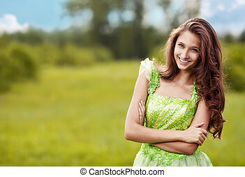 Portrait of a young beautiful woman on the nature