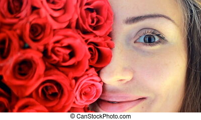 Portrait of a young beautiful woman with a bouquet of...