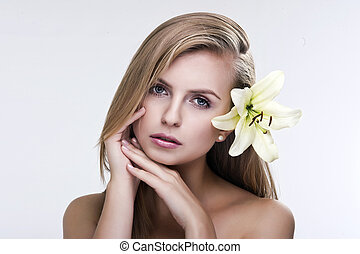 Portrait of a young beautiful woman with flower