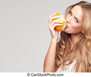 Portrait of a young beautiful woman with orange