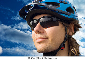 portrait of a young biker in helmet and glasses