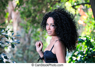 Portrait of a young black woman in the park