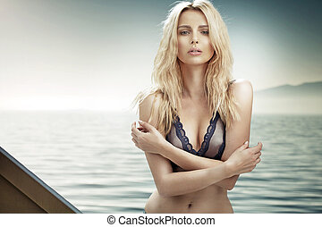 Portrait of a young blond woman with a perfect body
