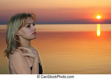 young blonde at sunset