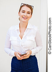 Portrait of a young blonde woman in jeans shirt