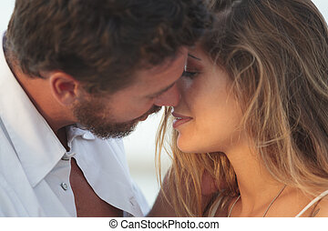young blonde woman kissing a man