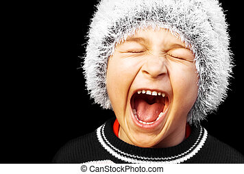 Portrait of a young boy screaming