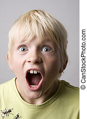 Portrait of a young boy shouting madly