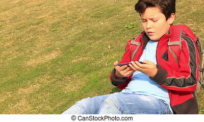 Portrait of a  young boy using smartphone