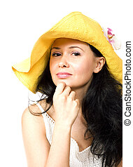 Portrait of a young brunette in yellow hat