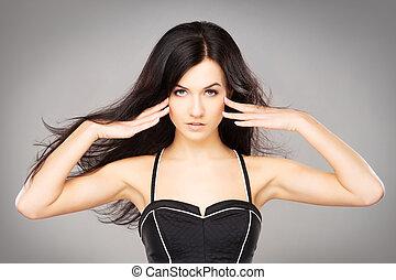 Portrait of a young brunette woman