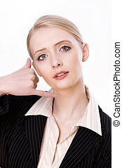 Portrait of a young business woman gesturing a call me sign against white background