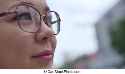 Portrait of a young business woman wearing glasses. Face of a blonde close up. The concept of successful women, professional, real people.