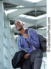 young businessman laughing at station
