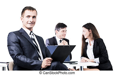 Portrait of a young businessman on background  working team