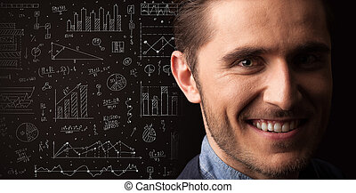 Portrait of a young businessman on dark background