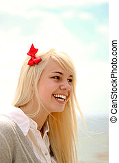Portrait of a young caucasian girl laughing