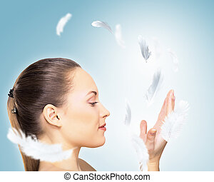 Portrait of a young charming girl on a background of soaring...