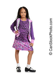 portrait of a Young child posing in purple outfit