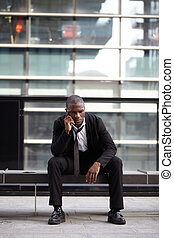 portrait of a young Confident afro american  businessman outdoor