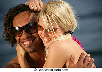 Portrait of a young couple at the beach