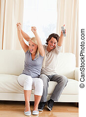 Portrait of a young couple cheering up