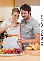 Portrait of a young couple drinking fruits juice