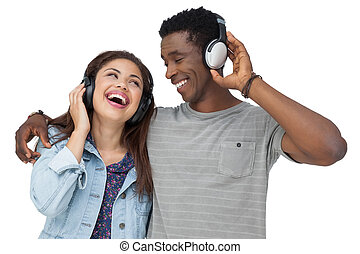 Portrait of a young couple enjoying music