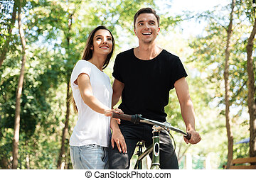 Portrait of a young couple riding on a bicycle together