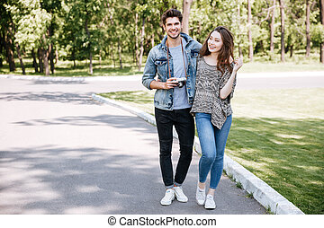 Portrait of a young couple walking in park