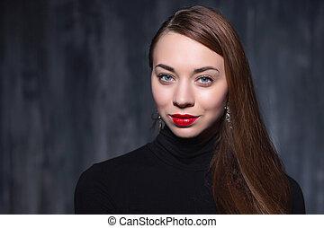 Portrait of a young cute brunette.