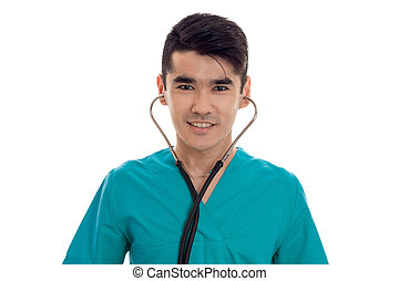 Portrait of a young doctor with stethoscope in your ears close-up