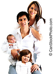 portrait of a young family with their newborn baby and daughter smiling