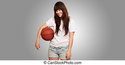 Portrait Of A Young Female With A Football Soccer Ball On...